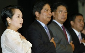 GMA with her economic managers (Photo from Reuters)