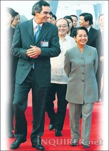 Mrs. Arroyo with crony Enrique Razon (photo from inquirer.net)