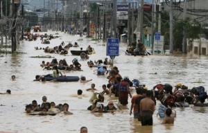 Residents wade in floodwaters caused by Typhoon Ondoy in Cainta Rizal east of Manila September 27, 2009 (photo from Reuters)