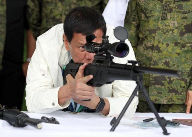 Duterte with gun